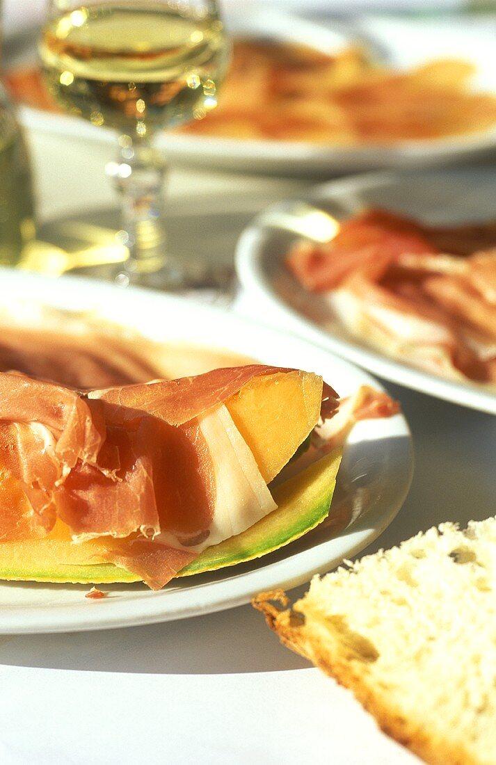 Prosciutto e melone (wedge of melon with San Daniele ham)