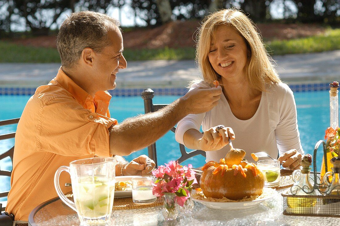 Holiday in Brazil: couple eating typical Brazilian dishes