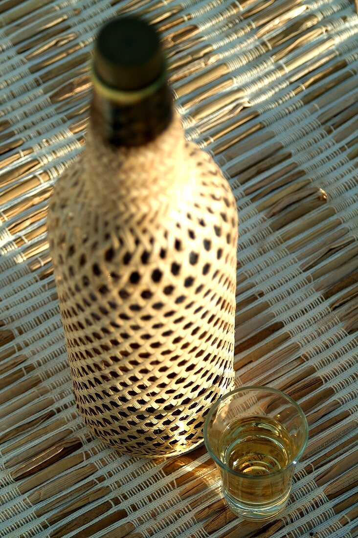 Bottle and glass of cachaca