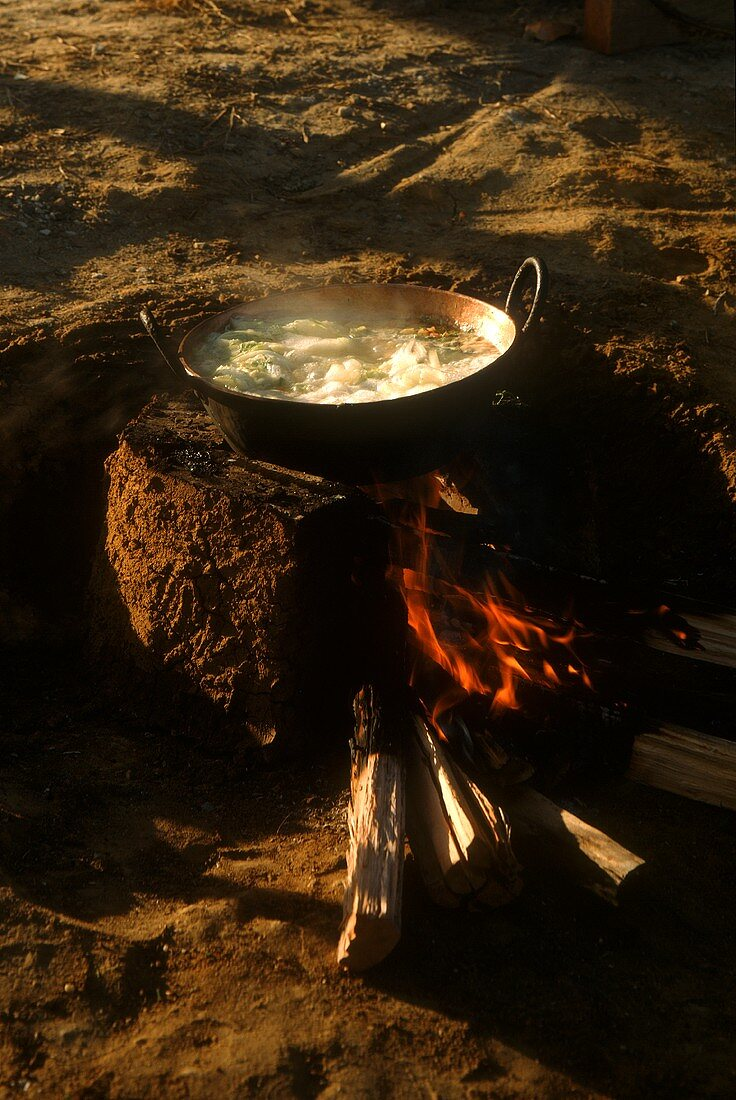 Afogado (Brazilian cabbage stew) on the fire