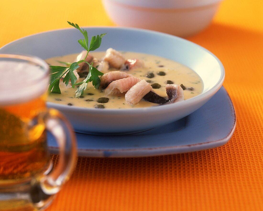 Dutch eel soup with capers and parsley