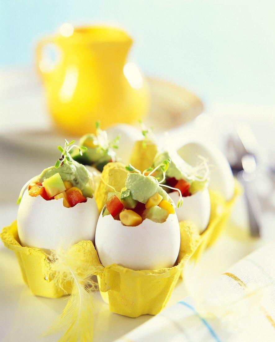 Sweetcorn salad and avocado cream in eggshell