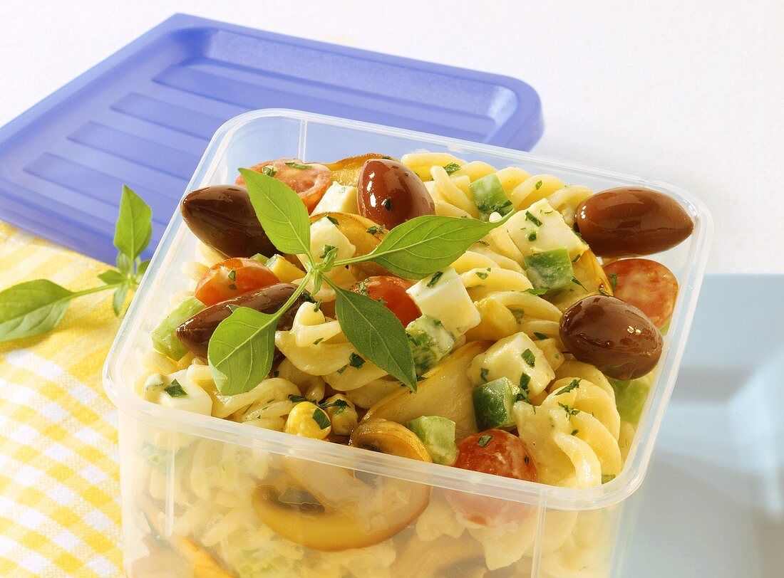 Pasta salad with mozzarella and vegetables in sandwich box