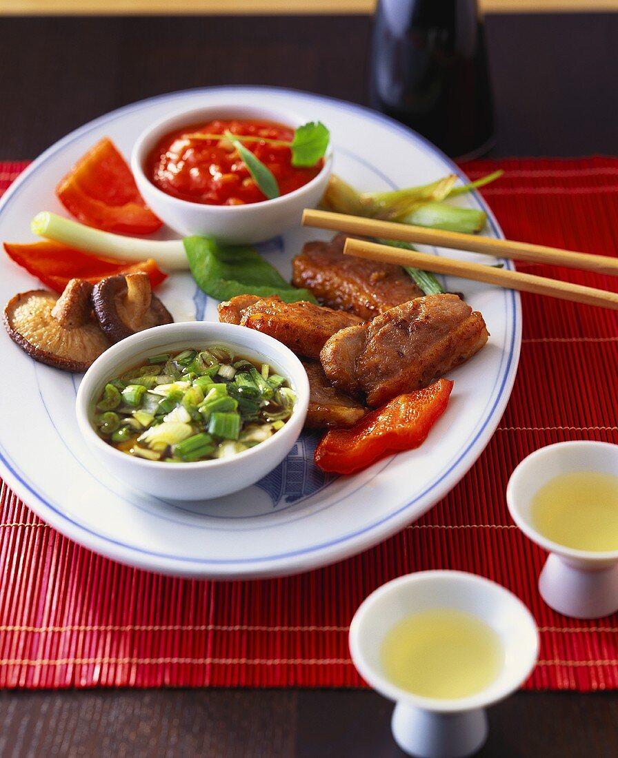 Deep-fried duck breast, chili sauce, spring onion & sake dip