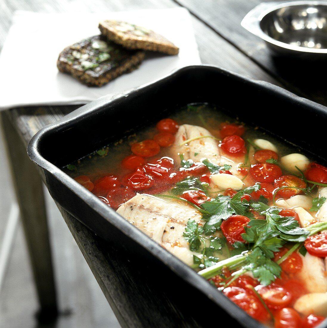 Pesce all'acqua pazza (fish in tomato sugo, Italy)