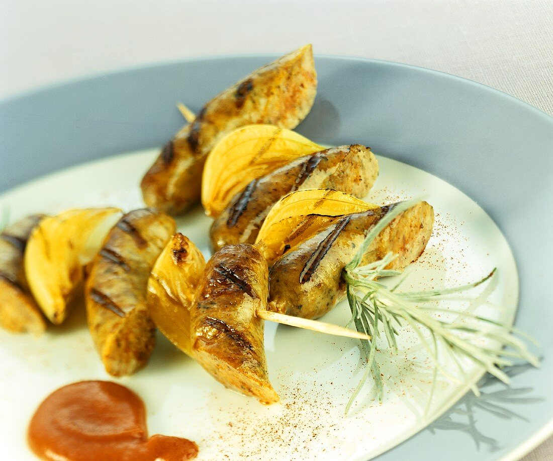 Barbecued sausage & onion kebabs with ketchup & mustard sauce