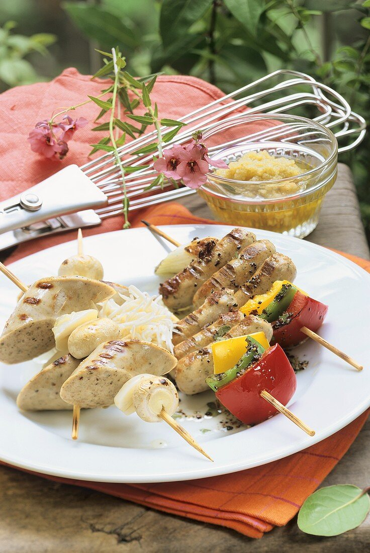 Sausage and pepper kebabs and sausage and mushroom kebabs
