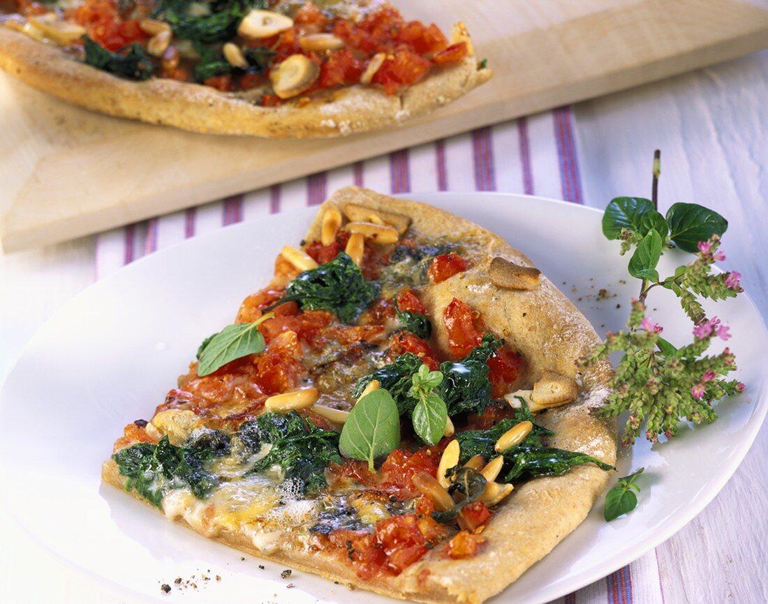 Pizza spinaci e pinoli (spinach pizza with pine nuts)