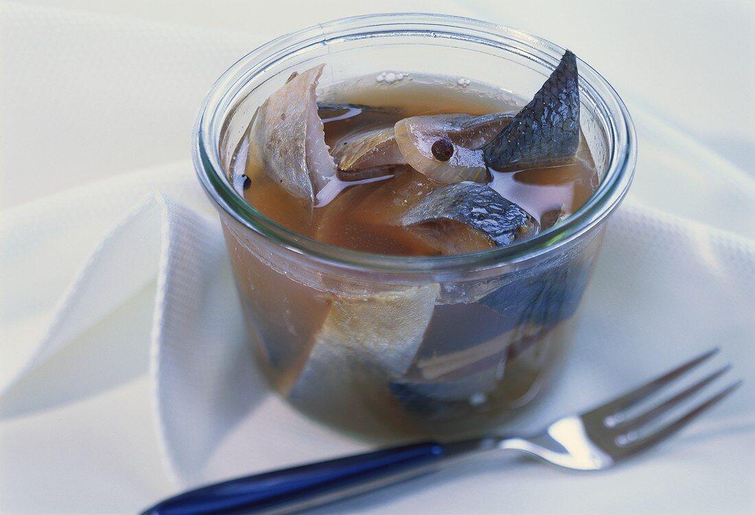 Pickled herrings in vinegar with onions
