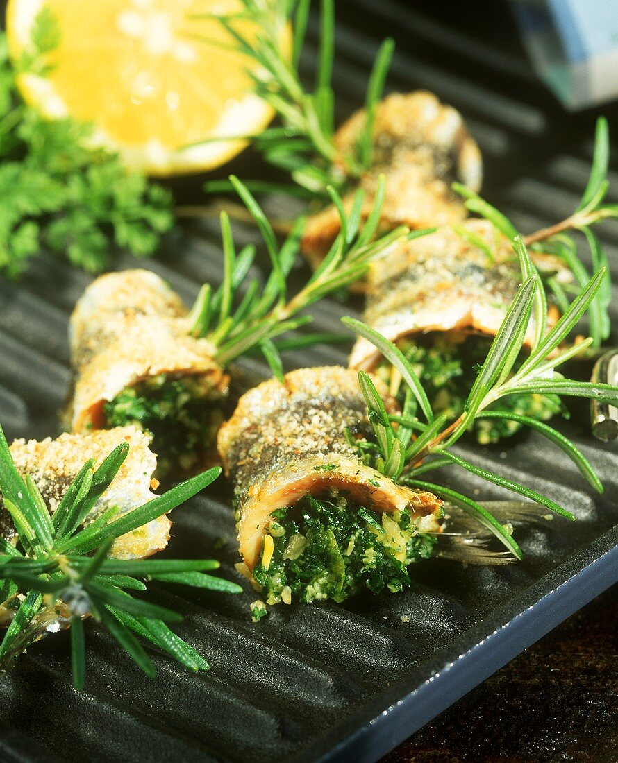 Grilled sardine rolls with herb stuffing
