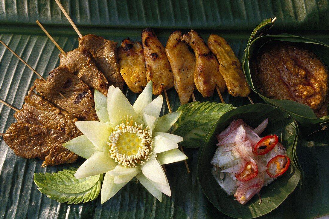 Satay gai and satay moo (chicken and pork kebabs)