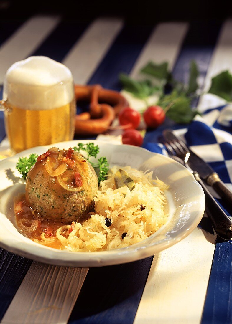 Liver dumplings with sauerkraut and bacon and onion sauce