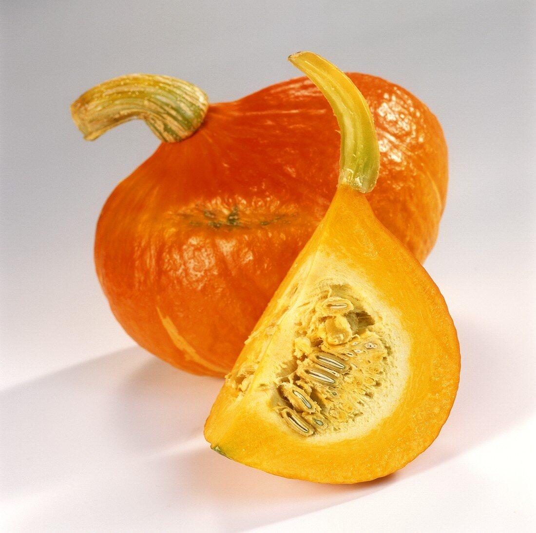 Whole pumpkin and wedge of pumpkin (Hokkaido)