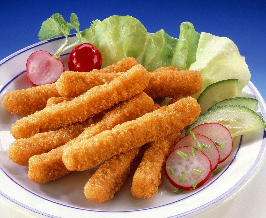 Breaded chicken sticks with salad