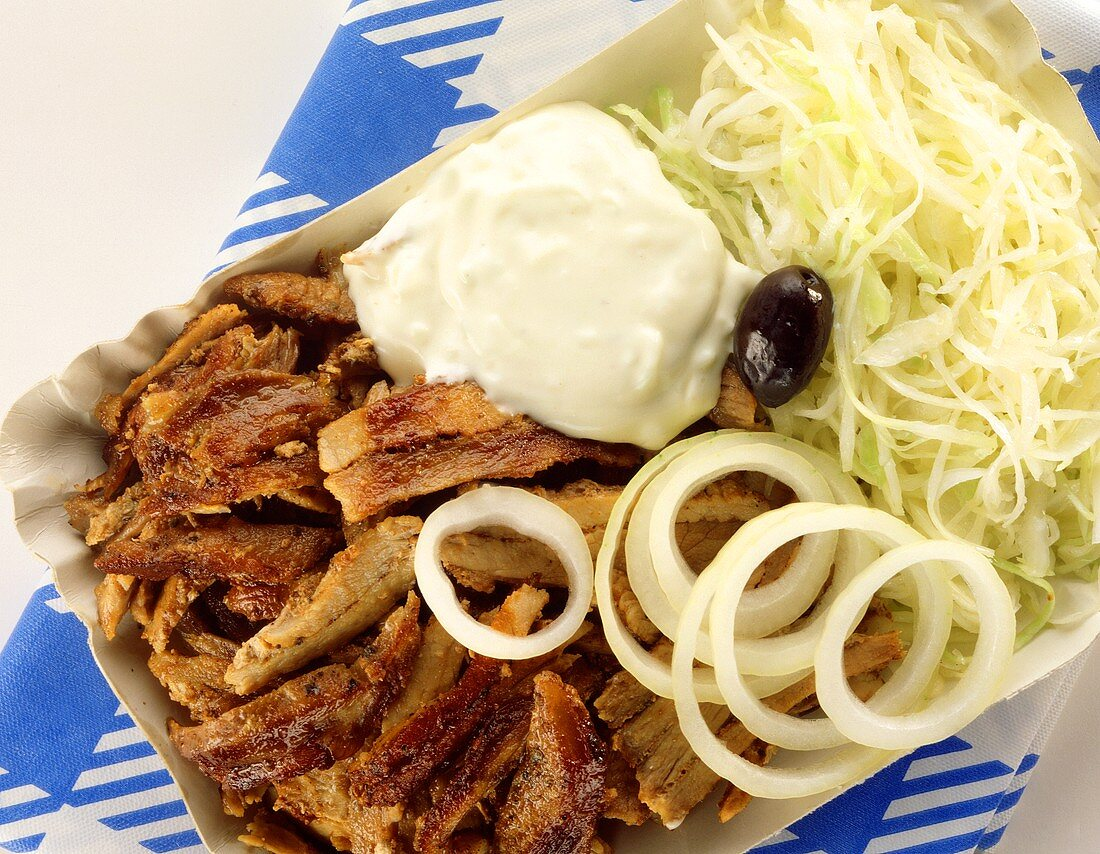 Gyros with onion rings, cabbage salad and garlic dip