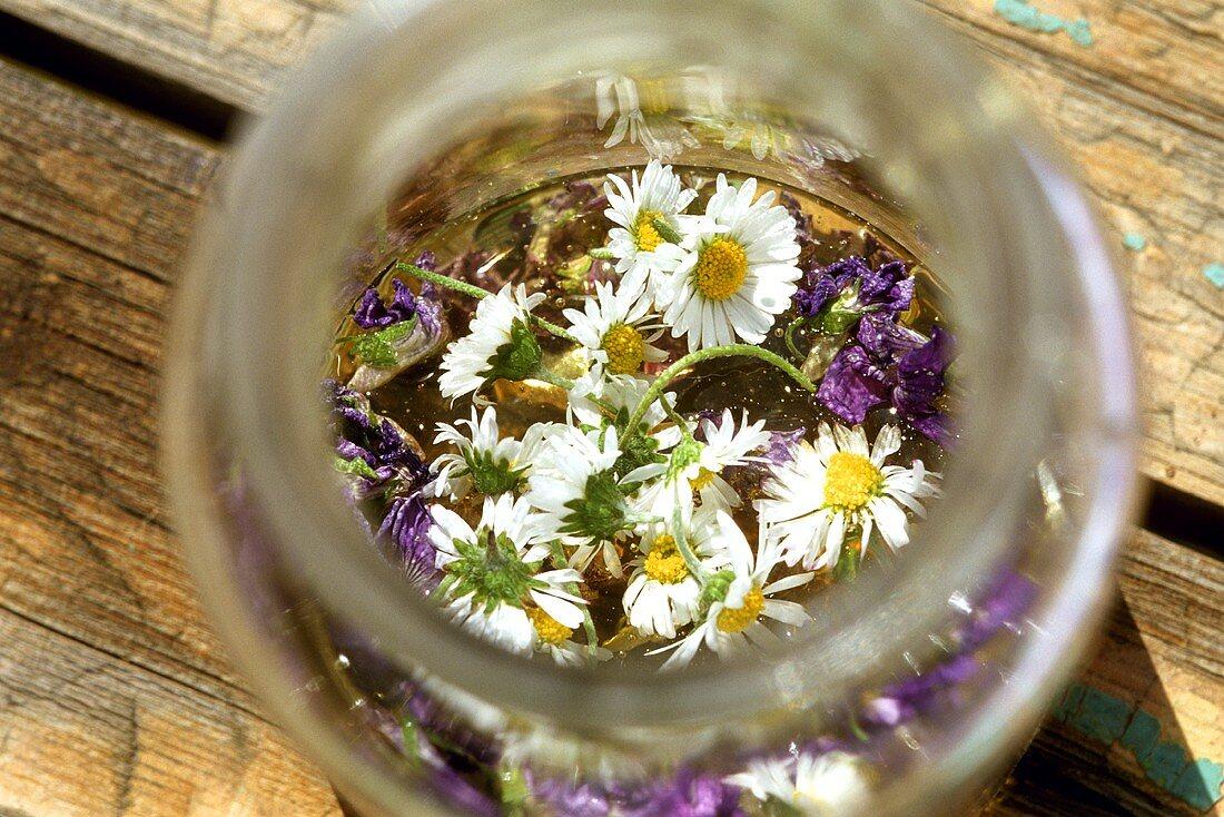 Fresh, edible flowers in acacia honey