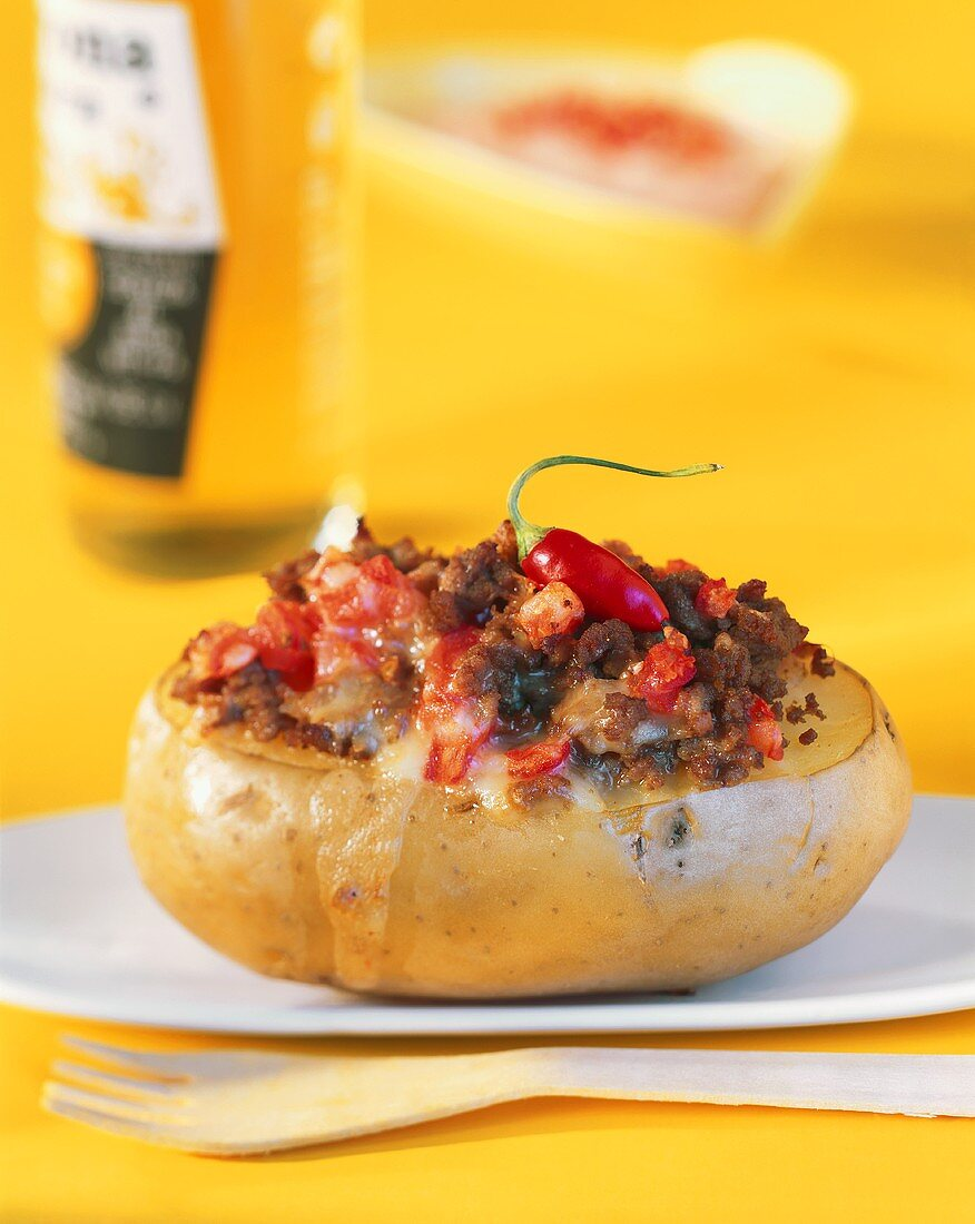 Baked potato with Mexican chili mince filling