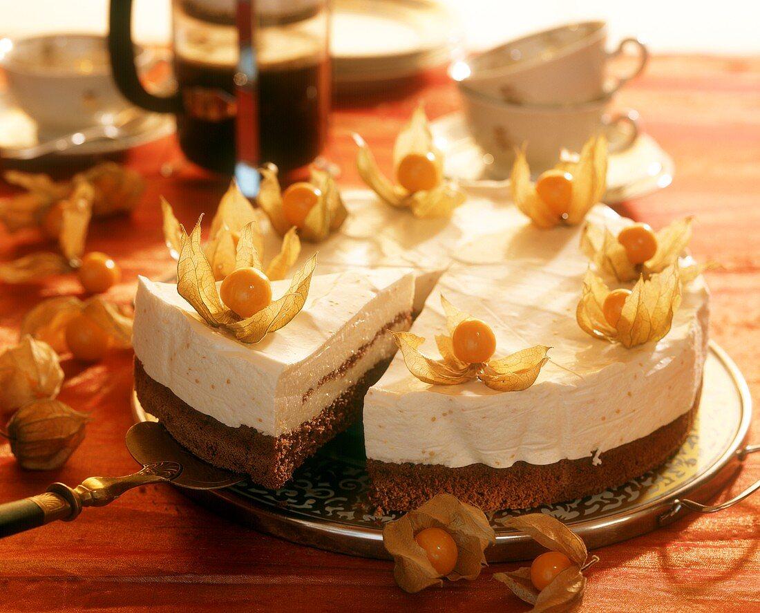 Peach cream gateau, decorated with cape gooseberries