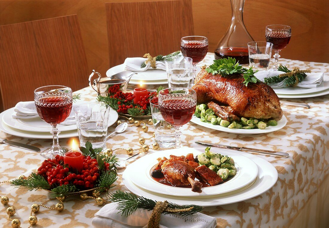 Stuffed duck with Brussels sprouts on festive table