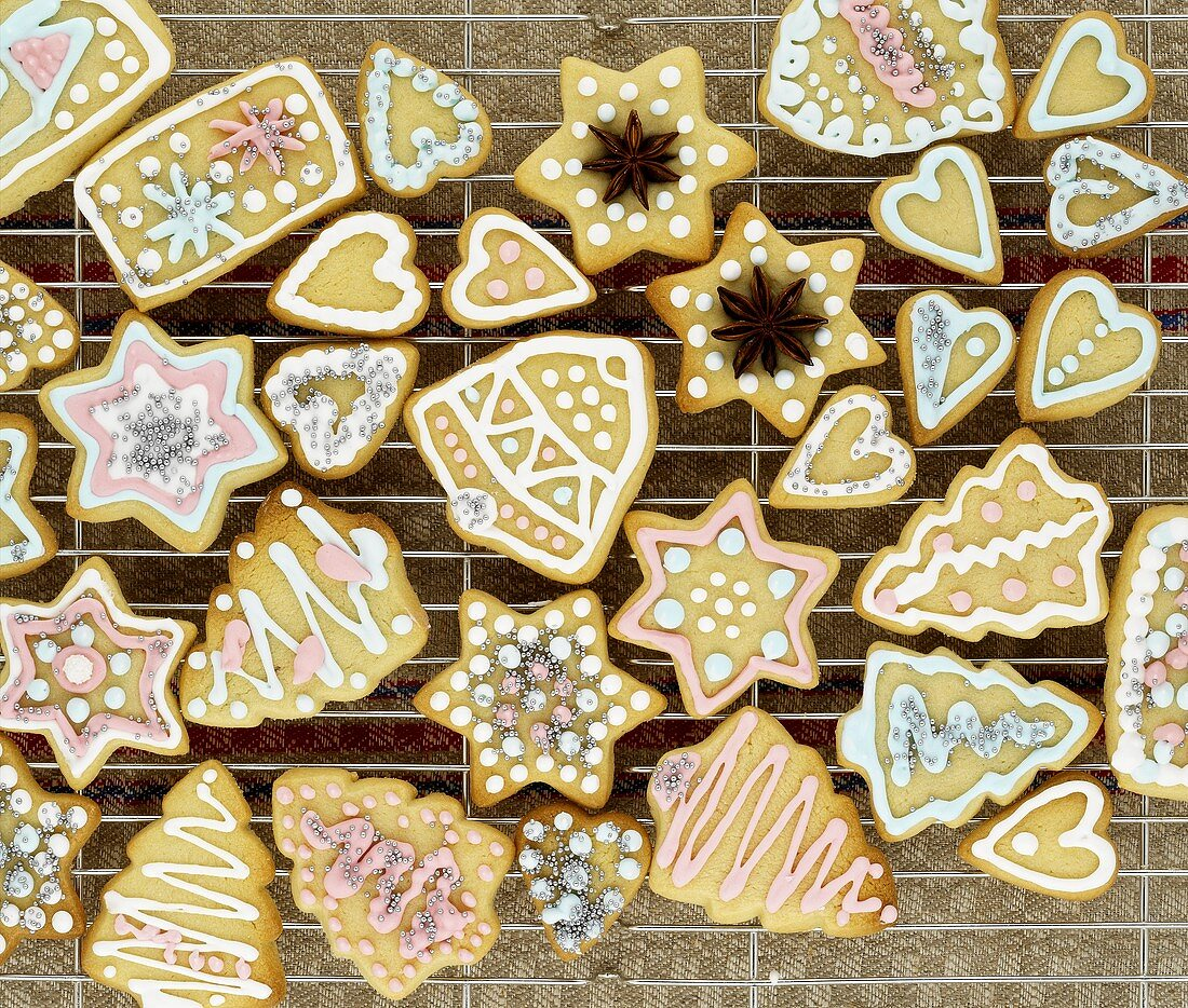 Several Christmas biscuits, decorated in pastel colours