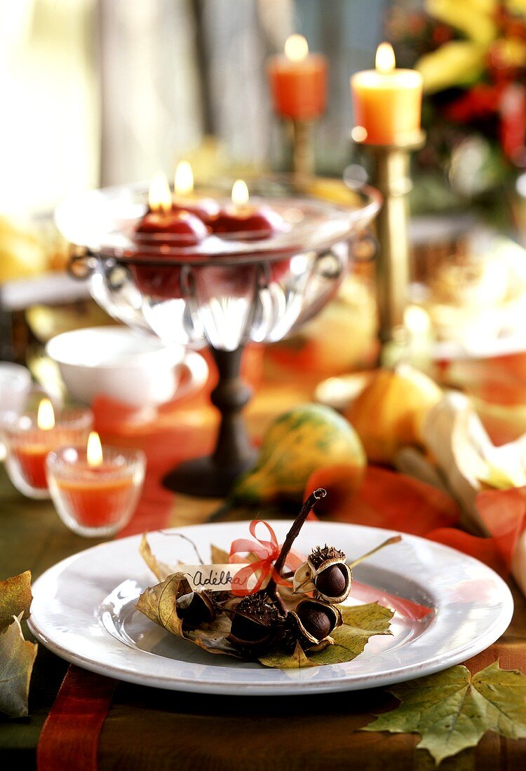 Table laid with autumn theme, with chestnut branch