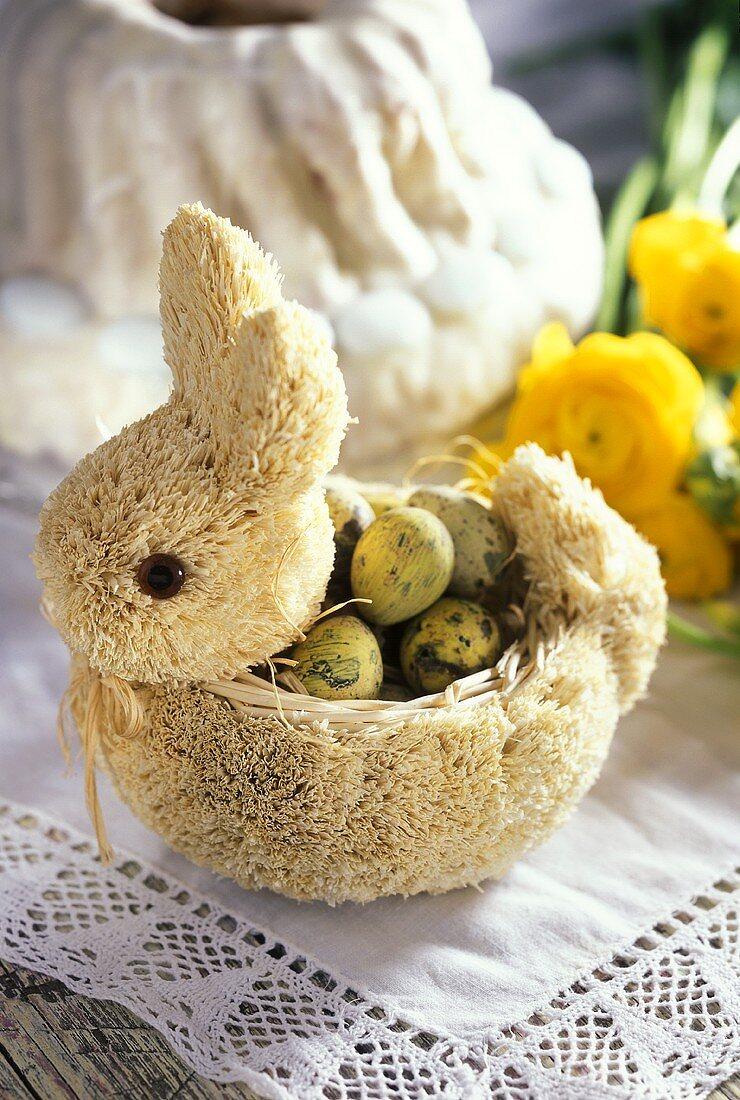 Fabric bunny with quail's eggs