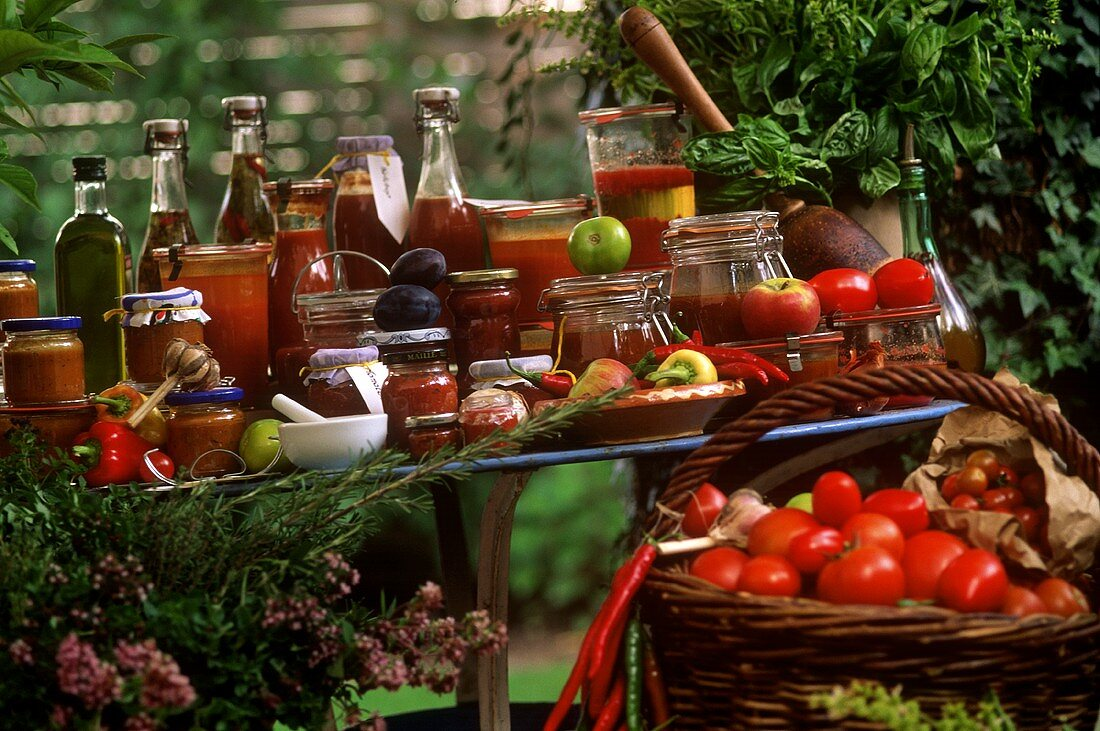 Still life with tomato, pepper and chili pickles & chutneys