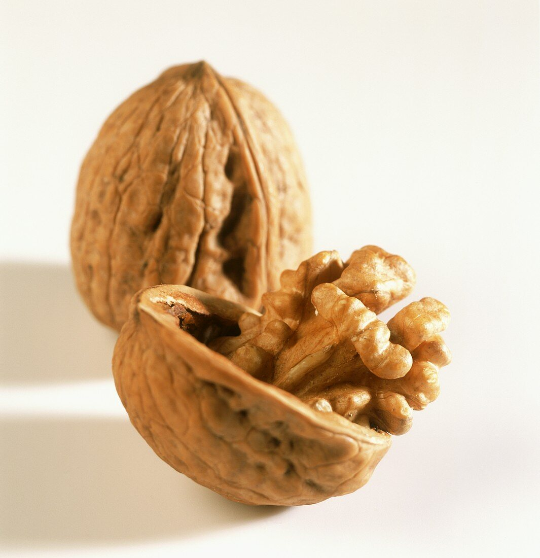 One opened and one whole walnut