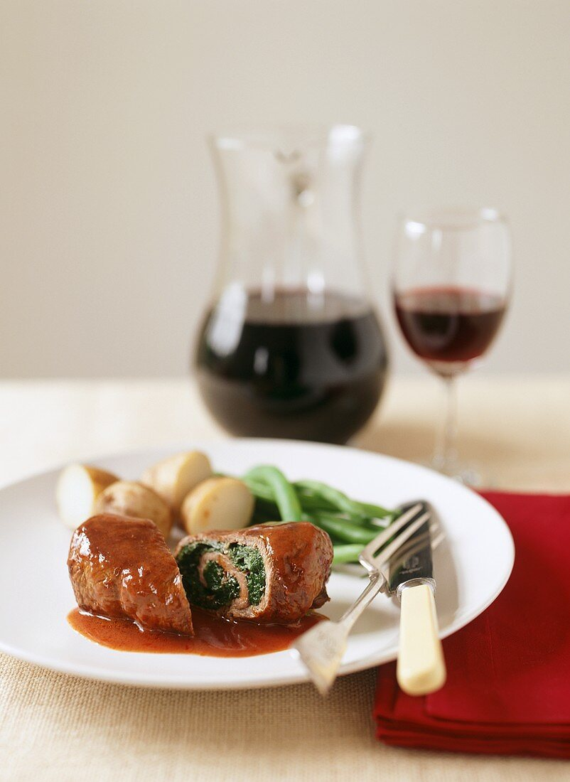 Beef roulade with spinach filling in red wine sauce