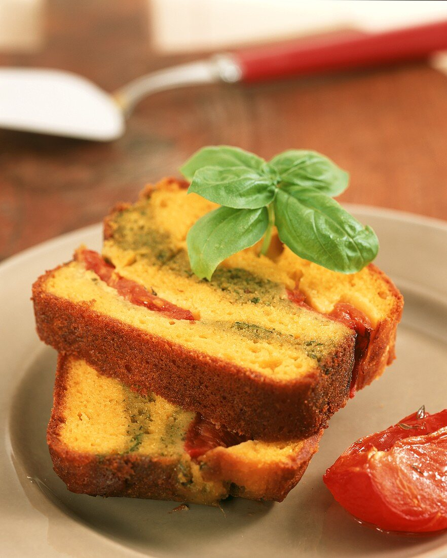 Two pieces of savoury cake filled with tomatoes & pesto cream