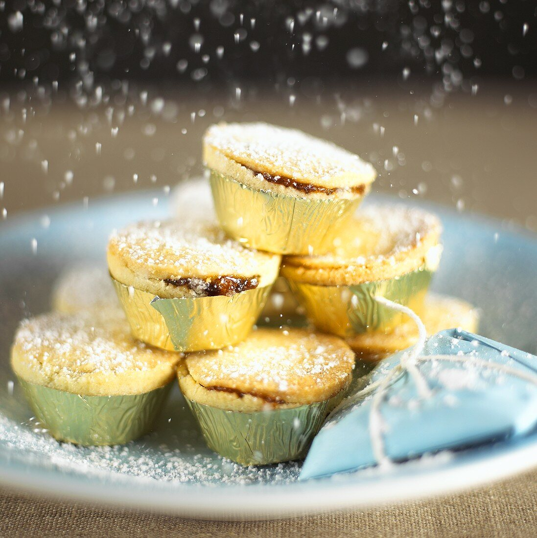 Dusting English mince pies with sugar