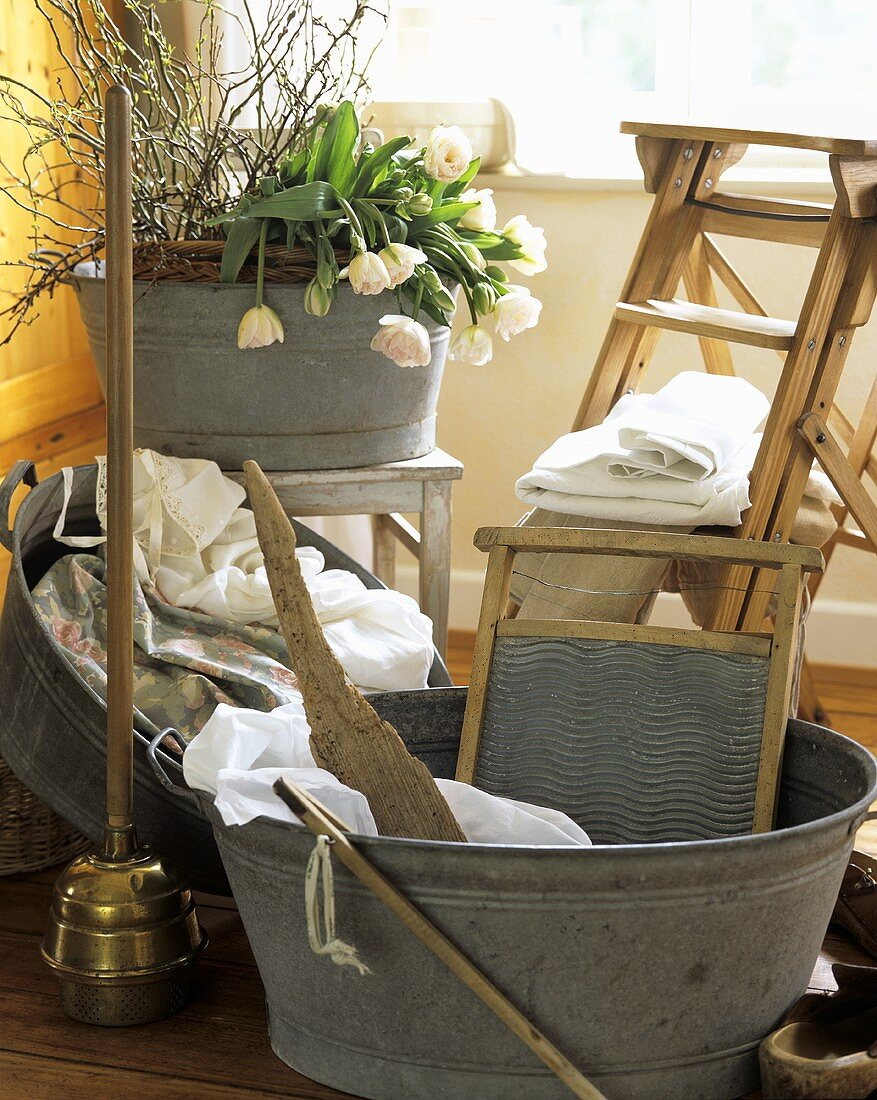 Washday: wash tub, washboard and posser