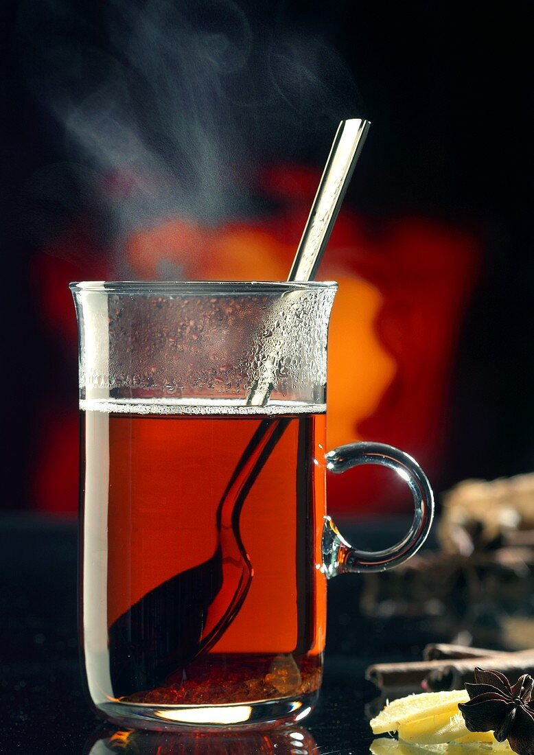 Hot tea punch with ginger and winter spices