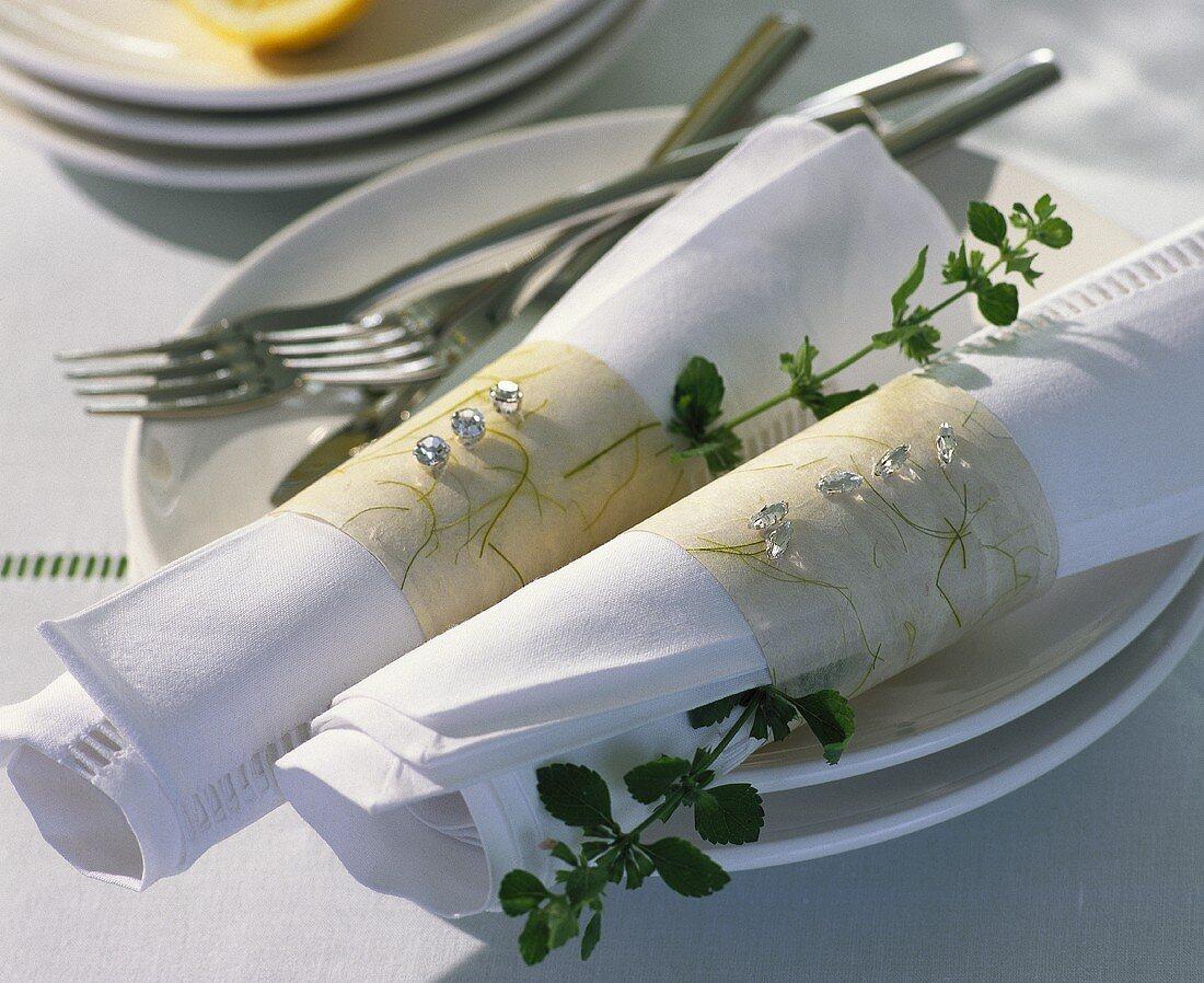 White fabric napkins with tissue paper napkin ring