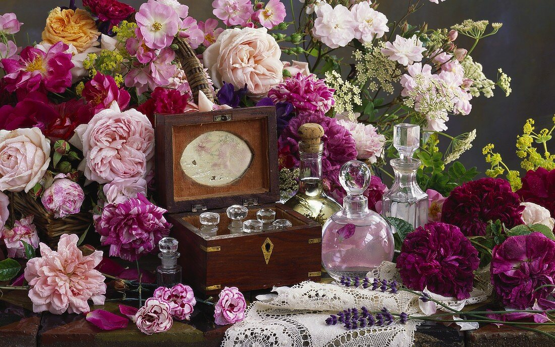 Roses and phials of rose perfume
