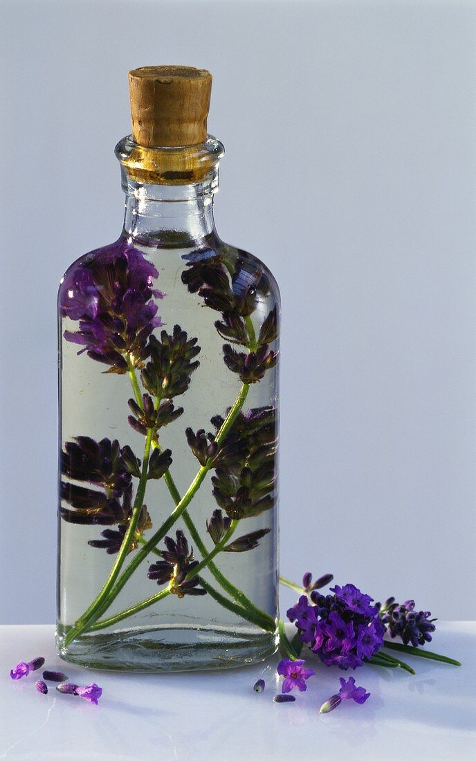 Glass bottle of lavender oil with cork