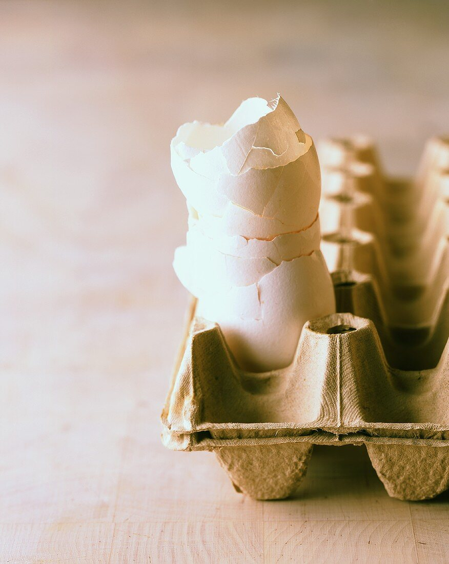Egg shells piled up in an egg box