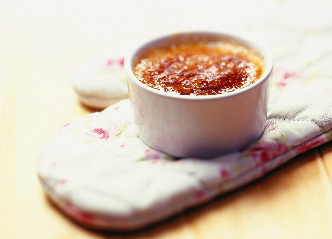 Crème brulee on an oven glove