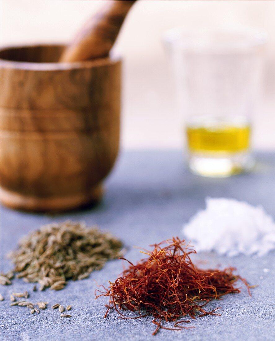 Caraway, saffron, salt and olive oil