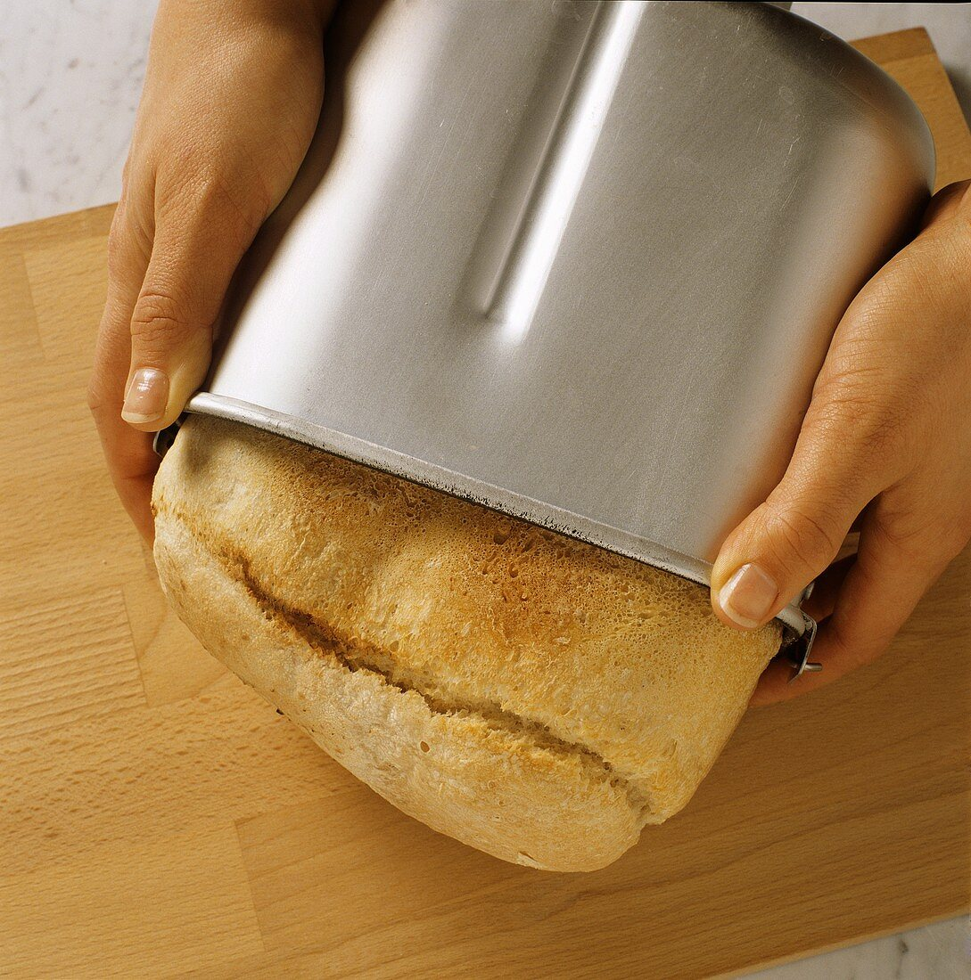Turning white bread out of the baking tin