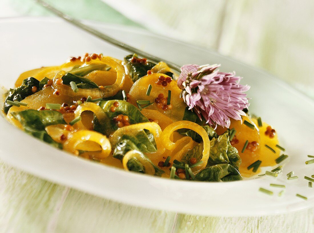 Curried potatoes with spinach, onions and chives