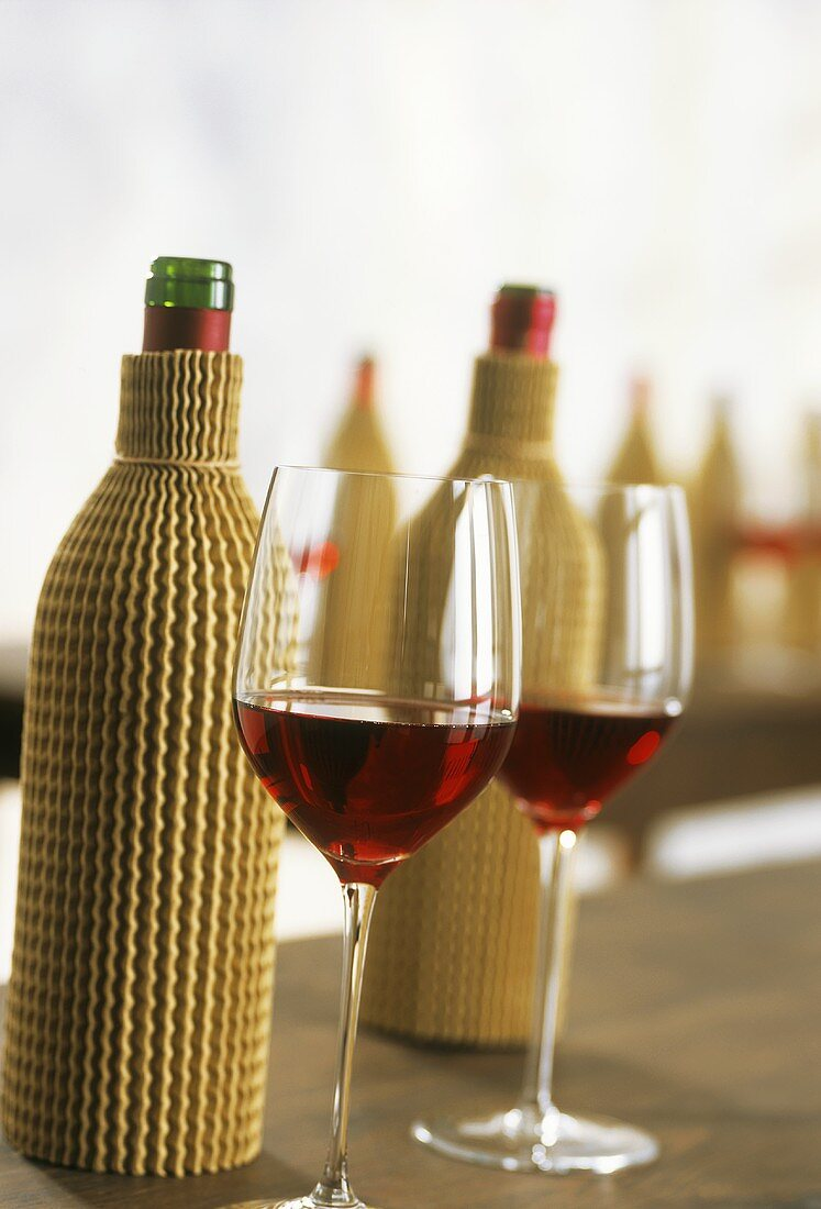 Blind wine tasting with covered bottles