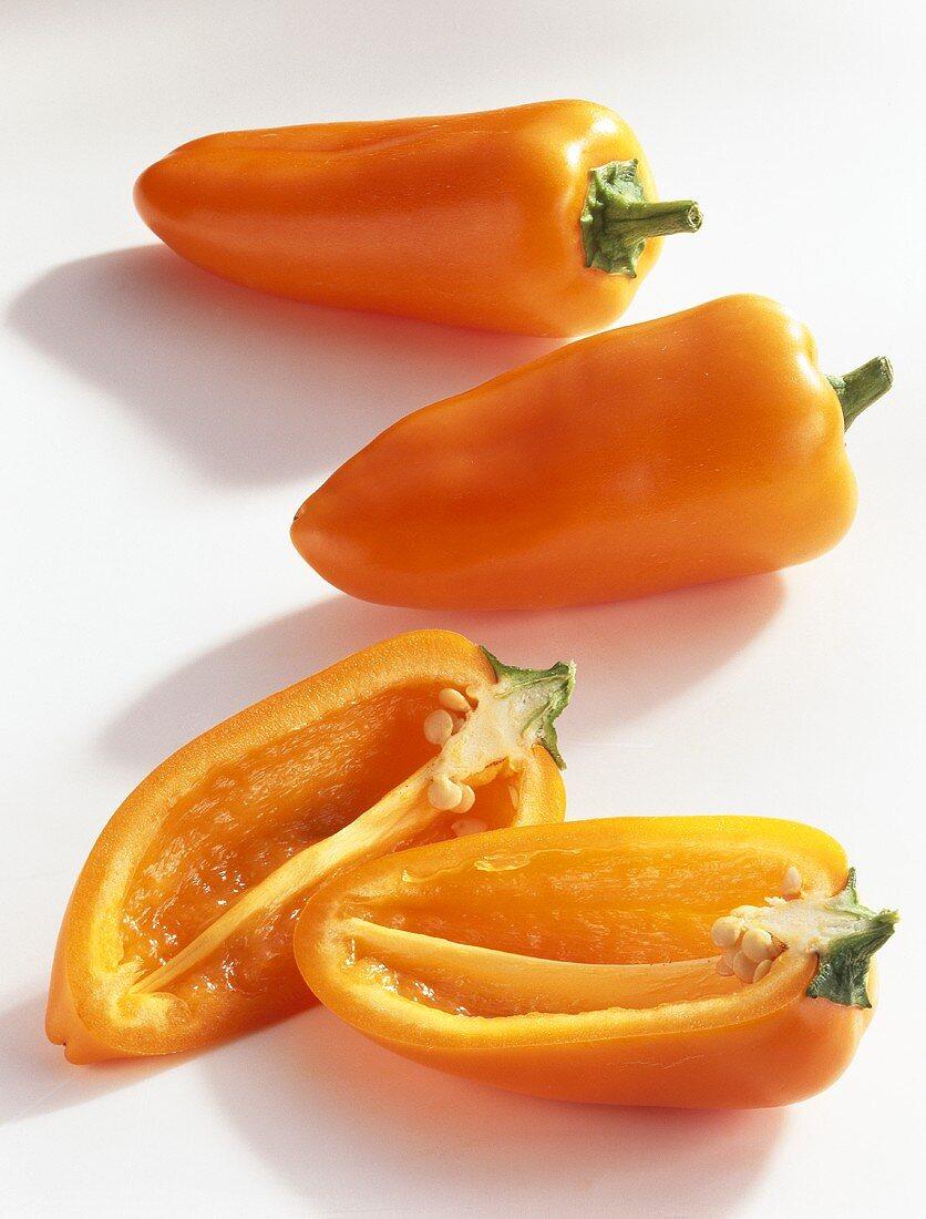 Baby pointed peppers (Capsicum annuum), orange