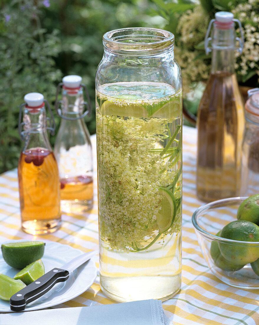 Elderflower champagne with limes, sugar and elderflowers