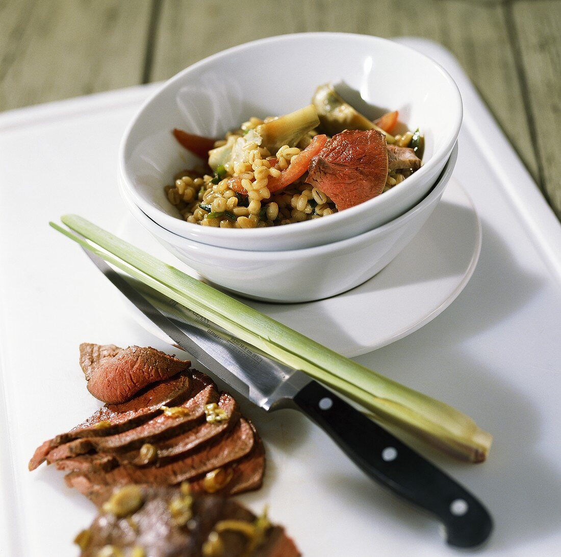 Roast leg of venison with barley risotto and lemon grass