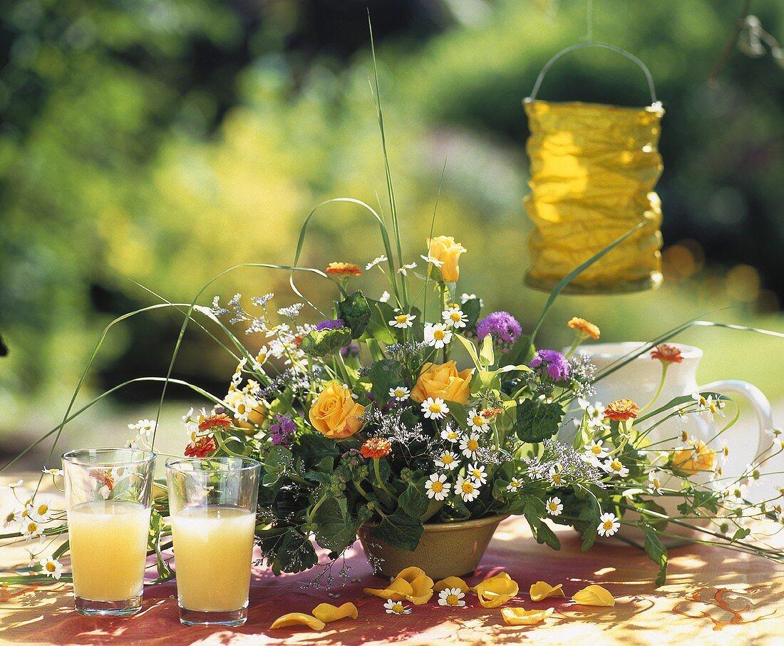 Roses, zinnias, Ageratum, marguerites in an arrangement
