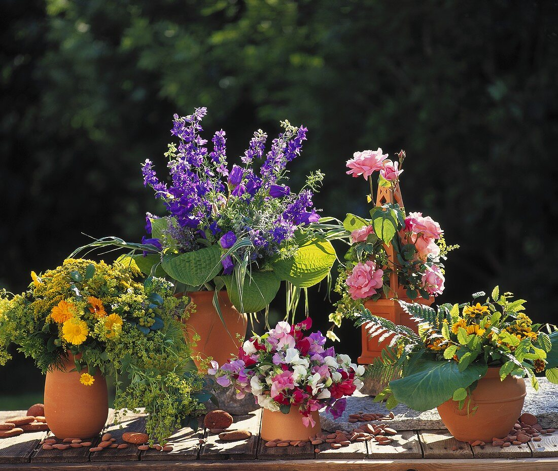 Vases of colourful summer flowers: roses, marigolds etc.