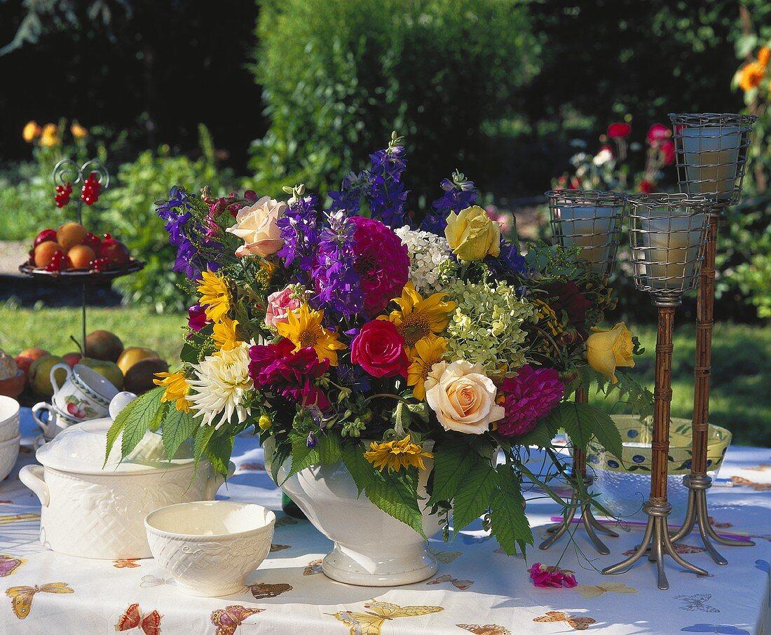 Colourful summer bouquet of dahlias, delphiniums, roses etc.