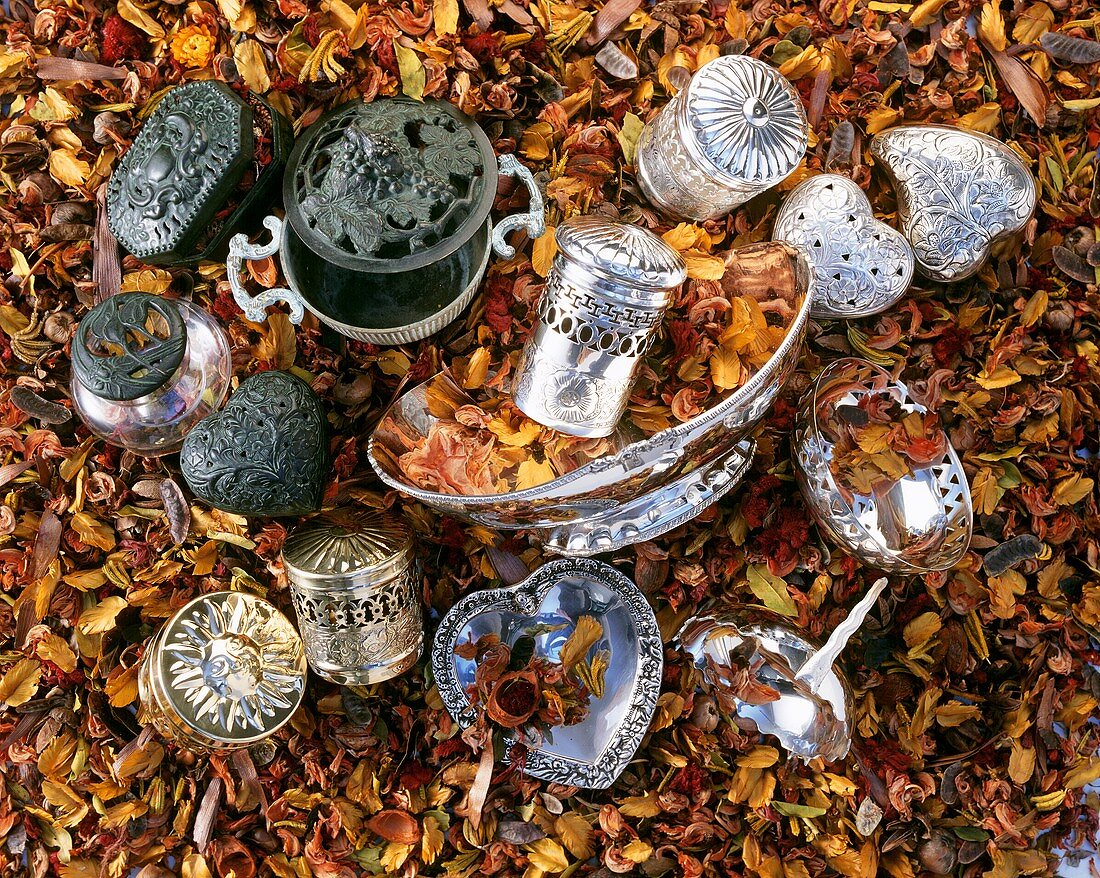Silver boxes and dishes in a sea of dried flowers