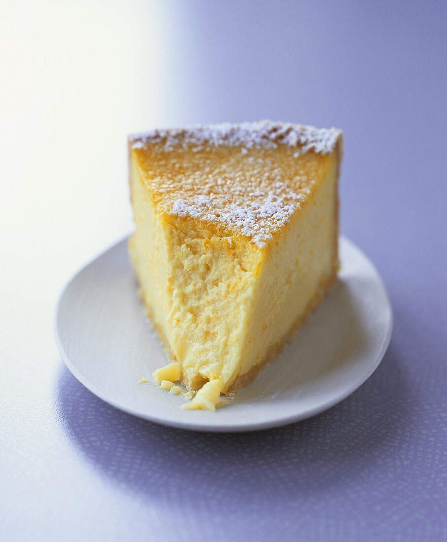 A piece of orange and lime cheesecake with a bite taken